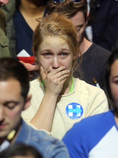 A Hillary Clinton supporter cries as she watches election