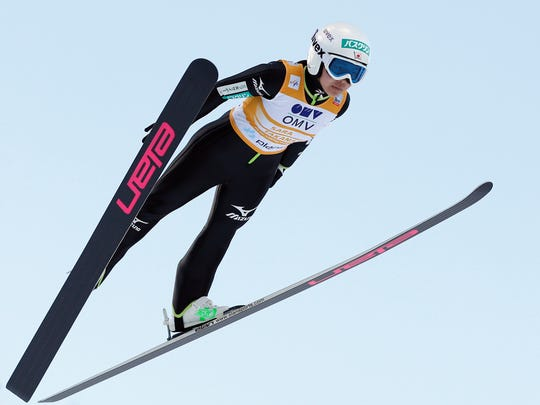 FILE - In this Jan. 25, 2014 file photo, Japan's Sara Takanashi competes at the women's Ski Jumping World Cup event in Planica, Slovenia.