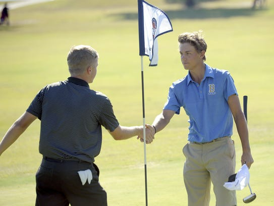 Brentwood sophomore Trenton Johnson shakes hands with