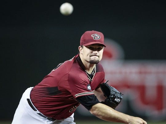 Arizona Diamondbacks' Zach Godley (52) pitches against