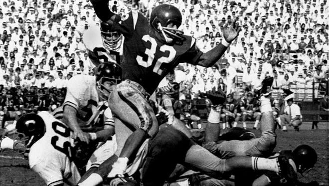 Southern California's O.J. Simpson tries to break a California tackle as he picks up five yards in Los Angeles Memorial Coliseum in this Nov. 9, 1968 file photo.