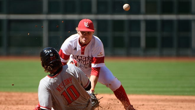 The ball gets away from Cajuns shortstop Hunter Kasuls on Saturday during the Shriner College Classic in Houston.