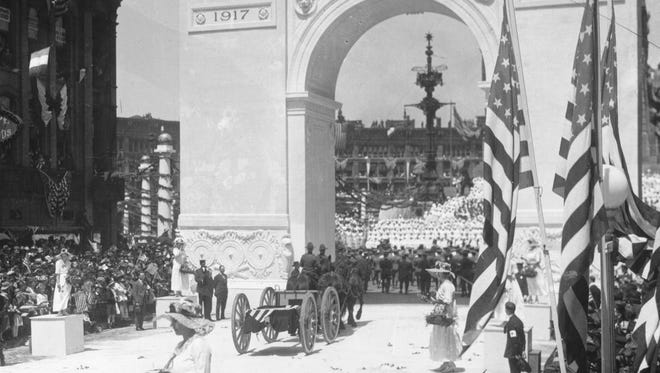 Thousands of people lined the streets in Indianapolis on May 7, 1919, to welcome home Indiana's returning World War 1 soldiers. Women threw flowers in the path of soldiers marching up Meridian Street to the Circle where a living Red Cross was formed on the steps of the Soldiers and Sailors Monument. A great victory arch  spanned the Meridian Street entrance to the Circle.