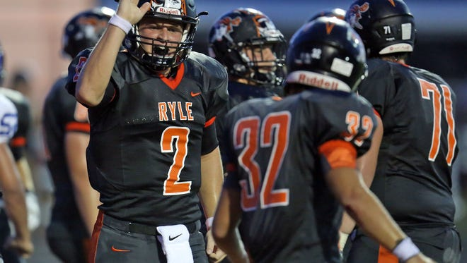 Ryle QB Tanner Morgan [2] high-fives RB Cole Burch after completing a two-point conversion.