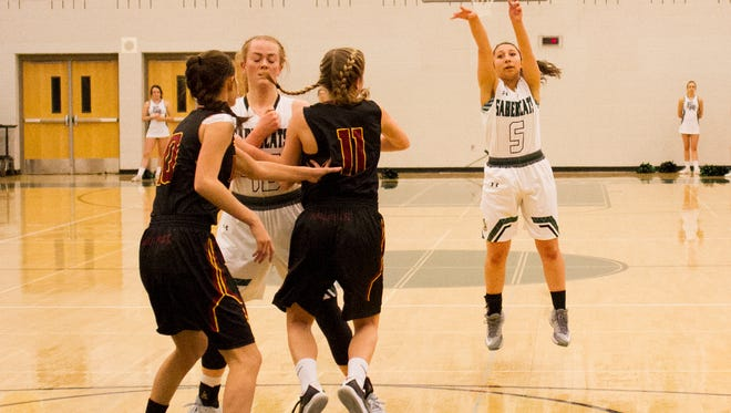 Fossil Ridge junior Katey Guzman (5) gets an open shot against Rocky Mountain Tuesday.