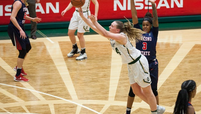 Colorado State forward Amanda Kantzy (24) shoots after being fouled by Fresno State's Tory Jacobs (3) Wednesday at Moby Arena in Fort Collins. Kantzy scored 16 points in 15 minutes for the Rams during their 73-56 home win.