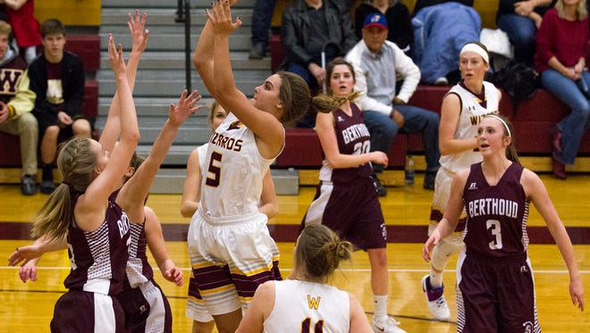 Windsor's Ally Kennis (5) gets high in the lane for a shot against the Berthoud defense Friday evening Jan., 20, 2017 as the Wizards beat the visiting Spartans 69-46 in Windsor. (Michael Brian/For the Coloradoan)