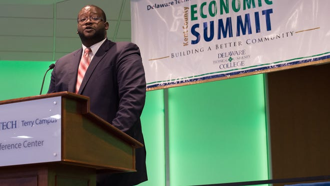 Cerron Cade, acting director, Delaware Division of Small Business, Development, and Tourism speaks at the 9th annual Kent County Economic Summit at Delaware Technical Community College in Dover. Cade's new division is expected to support the smaller businesses that collectively employ a little less than half of Delaware workforce.