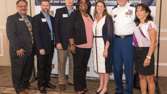 The 2018 Impact 100 grant finalists: Felix Cruz, Youth Guidance Mentoring; Jeffrey Shearer, Tykes & Teens; Tom Kindred, Indian River State College Foundation; Angela Davis-Green, Economic Opportunities Council; Kelly Sartain, Buggy Bunch; Col. Sam Kouns, Veterans Council and Linda Merk-Gould, Vero Beach Rowing.