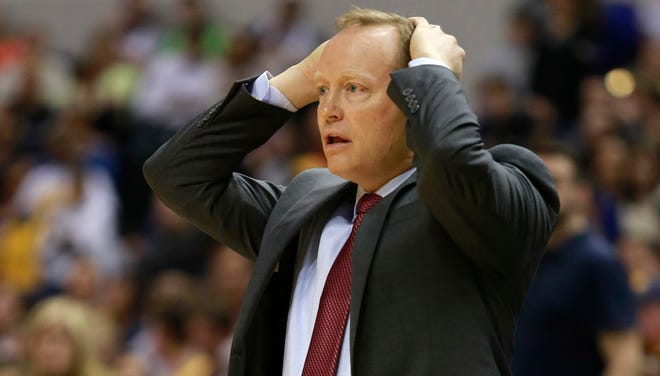 Atlanta Hawks head coach Mike Budenholzer puts his hands on his head in the second half of an NBA basketball game against the Indiana Pacers in Indianapolis, Sunday, April 6, 2014. (AP Photo/R Brent Smith)