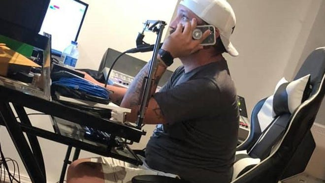 Animal Services Advisory Board Chairman Jesse Fenwick, a member of Cajun Navy Relief & Rescue, communicates remotely with his comrades during their response to Hurricane Laura on Thursday, Aug. 27, 2020, in Fort Smith.
