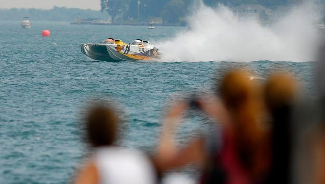 Cat Can Do races on, Sunday, July 27, 2014 during the St. Clair River Classic Offshore Boat Race.