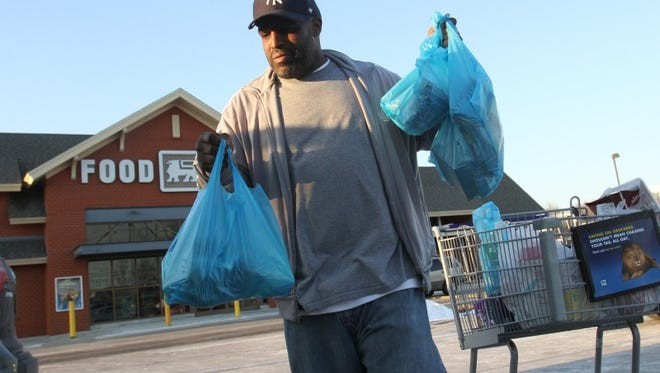 Erick Coleman, 42, of New Castle, shops with food stamps at the Food Lion in Newark.