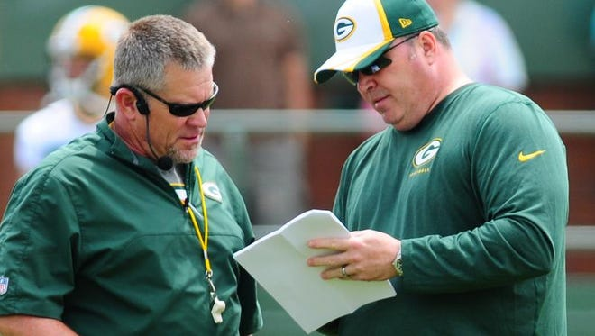 Green Bay Packers coach Mike McCarthy, right, with special teams coordinator Shawn Slocum during OTA practice at Ray Nitschke Field, Tuesday, June 10, 2014.