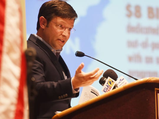 Congressman Mike Johnson, R-Benton, is pictured hear during a recent town hall meeting in Bossier City.