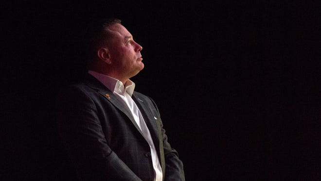 Tennessee coach Butch Jones watches during the signing day celebration at the Tennessee Theatre on Wednesday.