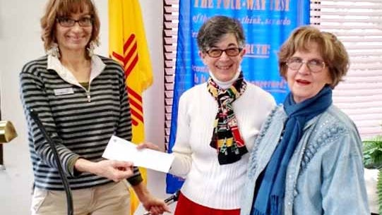 Rotary Club President Leslie Bush, at left, presented checks on Dec. 15 from the Silver City Rotary Foundation to Helen Shoup, at right, representing the Museum Society, and to Phyllis McQuaide, center, representing the Community Theatre.