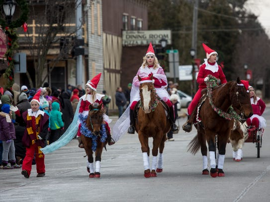 Participants are dressed as elves during the 2016 Old