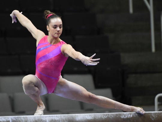 Maggie Nichols trains on the balance beam in the women's