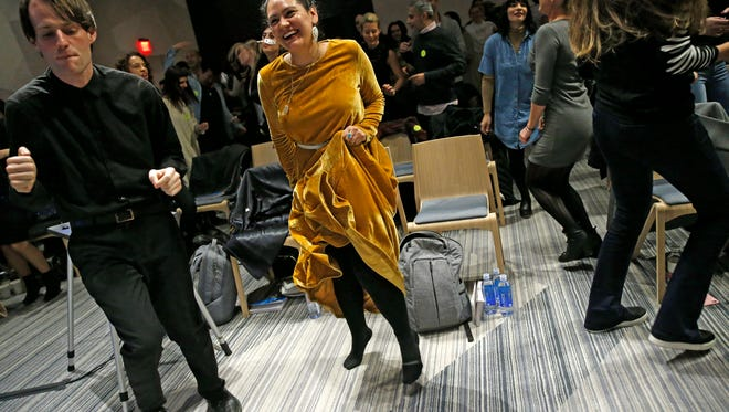 In this March 8, 2017 photo, Andrew Hoepfner, left, and Pamela Martinez, center, dances along with participants at a sober social event sponsored by The Shine at a hotel in the Williamsburg neighborhood of the Brooklyn borough of New York. Alcohol-free events, which are popping up in New York, Los Angeles and Chicago, are part of a trend fueled by millennials seeking to find meaningful connections while they party. (AP Photo/Kathy Willens)