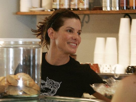 Actress Sandra Bullock serves customers pastries at the grand opening of her sister's bakery, Gesine's Confectionary , in Montpelier, Vt., Tuesday, Aug. 2, 2005. Both Bullock and the pastries turned out to be big draws because the pastries sold nearly as fast as Bullock's sister, shop owner Gesine Prado, could churn them out of the kitchen in the back of the renovated shop in a largely residential area on the northern fringe of the state capital.