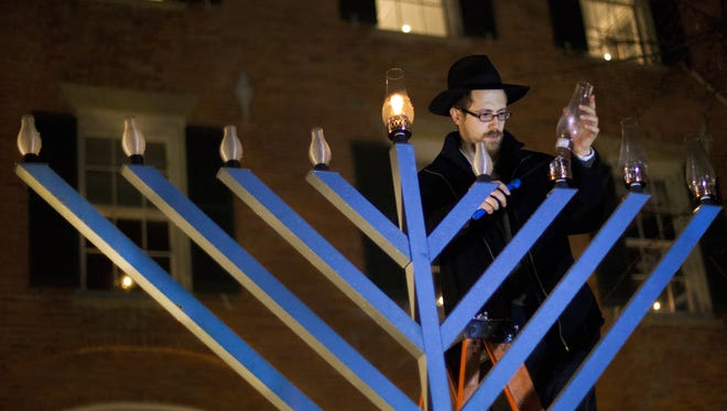 A file photo from the Pittsford village Hanukkah celebration in 2012.