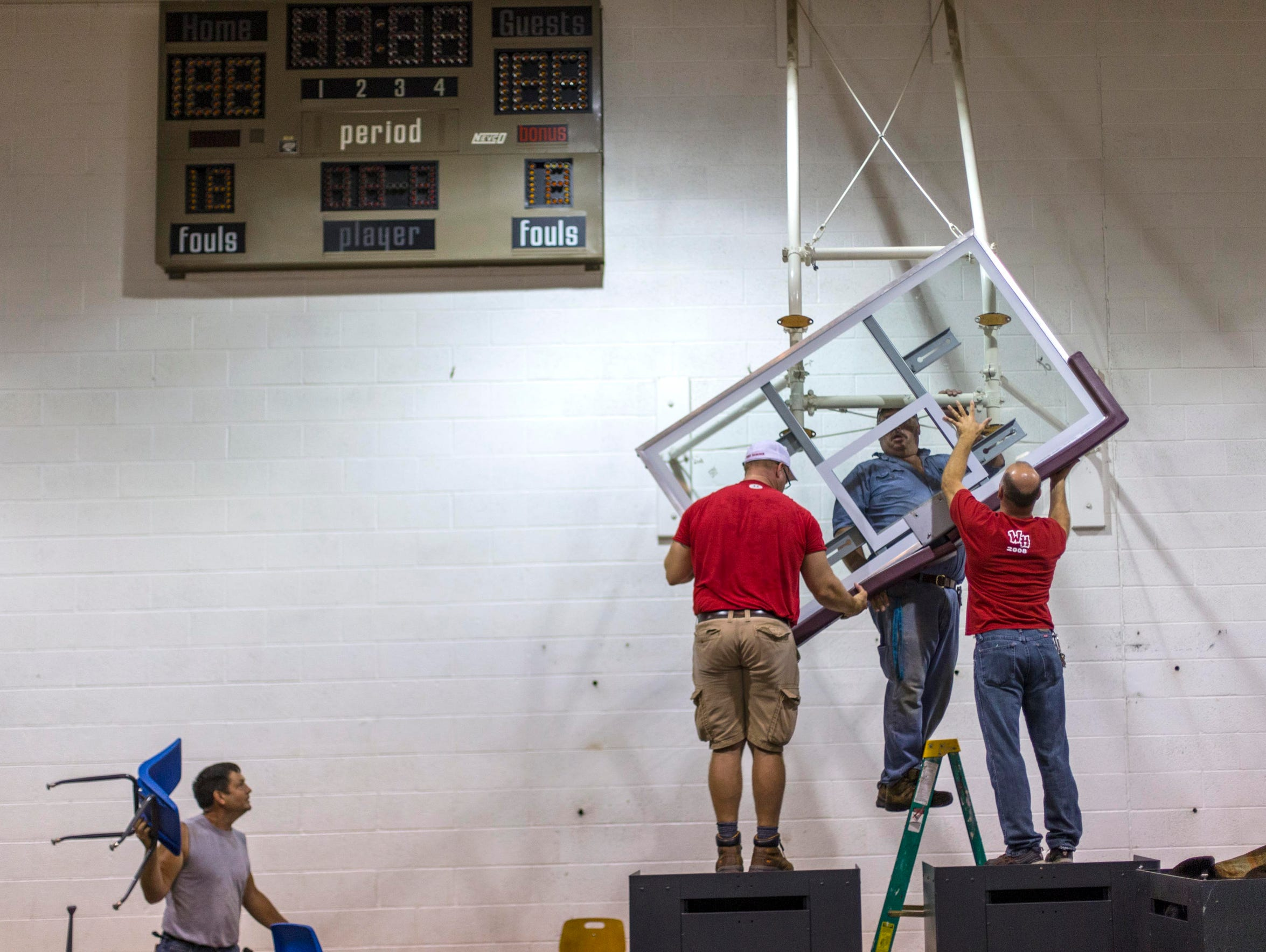 The basketball goals are removed in the gym Saturday