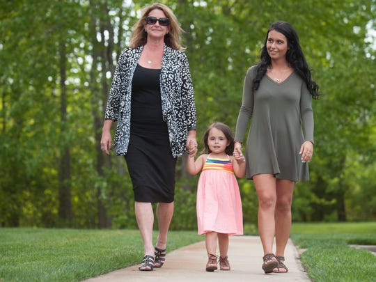 Ashley Segars, 25, right, who is in recovery from an opioid addiction, walks with her 4-year-old daughter Giavonna, and her mother Karen Sulkin near Sulkin's Marlton home.