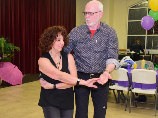 Connie Adams and Dennis Adams dance the two-step to