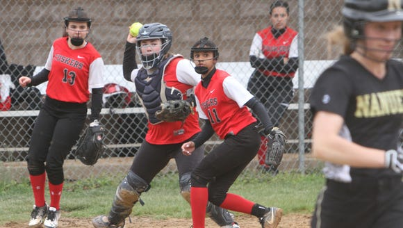 Somers catcher Gabby Mazzotta field a ball against