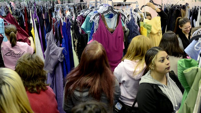 Girls can choose from approximately 1,200 dresses at the SnoBall Formal Wear Giveaway 5 to 9 p.m. Saturday, Nov. 7, at The Bridal Gallery, 180 Liberty St. SE.