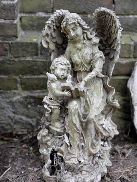 This small statue once marked the grave of a loved one buried in the cemetery attached to the Fredericksburg Baptist Church.