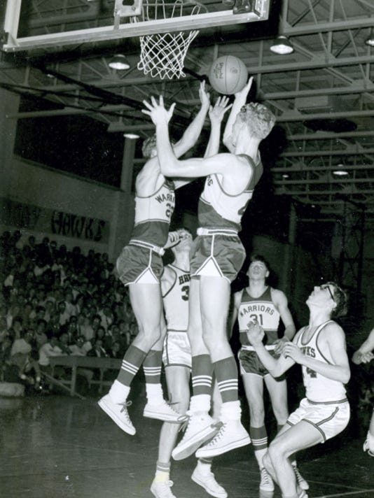 Susquehannock boys' basketball players Andy, right, and Danny Mays go up for a rebound during the 1969 YCIAA championship game against Hanover at Gettysburg College. The Warriors, who won the Eastern Division, lost to Hanover, the Western Division champs, 70-56. Both teams advanced to the District 3 Class B playoffs, where No. 8-seeded Susquehannock knocked off Middletown, the defending state champs en route to their march to the title game.