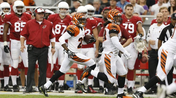Cincinnati Bengals cornerback Terence Newman (23) runs the ball back for a touchdown after an interception in the first quarter against the Arizona Cardinals at the University of Phoenix Stadium.