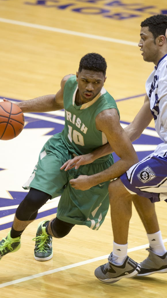 Cathedral High School junior Eron Gordon (10) makes a drive to the basket during second half action. Ben Davis High School hosted Cathedral High School in boy's varsity basketball Friday, Feb. 20, 2015. Ben Davis won in overtime 61-55.