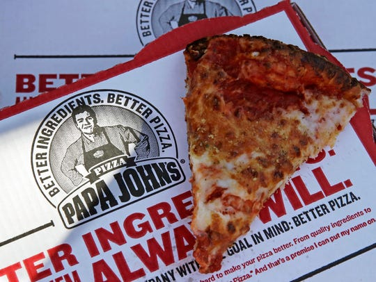 Photo shows a slice of cheese pizza at the Papa John's