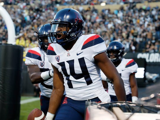 Arizona quarterback Khalil Tate celebrates after running for a touchdown against Colorado in the first half of an NCAA college football game Saturday, Oct. 7, 2017, in Boulder, Colo. (AP Photo/David Zalubowski)