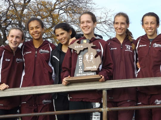 Seaholm's girls cross country squad raced to its sixth straight Division 1 regional championship Oct. 29 at Metro Beach Matropark.