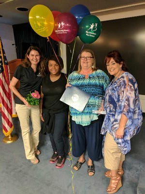 Escambia County Big of the Year, 2017. Left to right: Liza Hawkins (match specialist), Tymeisha (Little Sister), Elana Garvin (Big Sister), Angie Brewer (match specialist).
