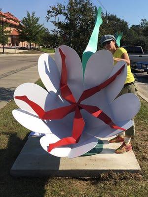 """Joni Younkins-Herzog installs her sculpture, """"Laideedee."""""""