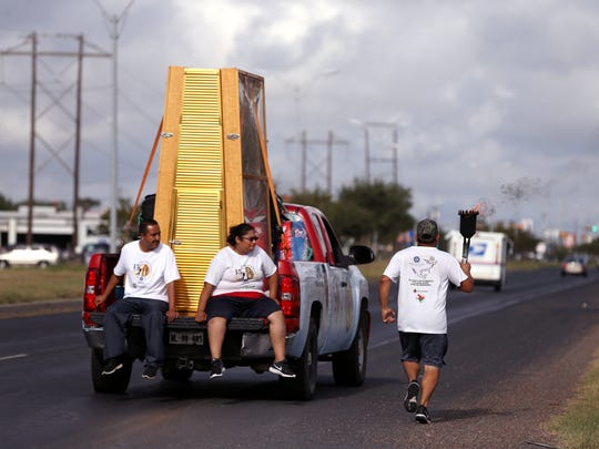 Fernando Fernandez runs with a the torch during the 15th annual Carrera Antorcha Guadalupana torch run on Tuesday, Nov. 1, 2016 along Leopard Street. The run begins in Mexico City, Mexico and continues to New York City, New York. It brings attention to the need for immigration reform, organizers said.