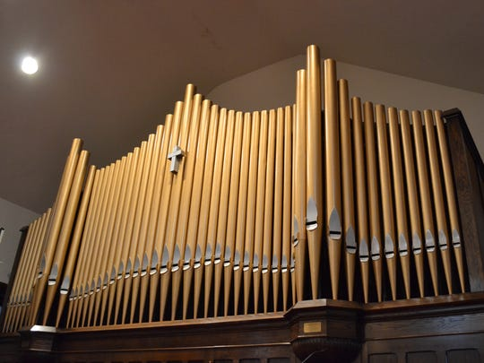 The pipes of the pipe organ tower over the historic church's sanctuary.