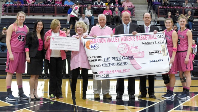 Lebanon Valley College continued their support of breast cancer awareness Wednesday evening, Feb. 8 with two check presentations before the 10th Annual Pink Game. The first check went to the American Cancer Society. The second presentation, by Jeanne and Ed Arnold, and LVC President Lewis Thayne for $10,000.00, was presented to Dr. Maria Baker and the Penn State Health Cancer Institute Genetics Program.