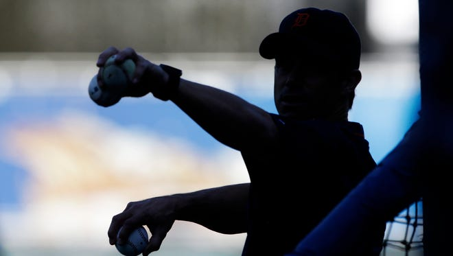 Detroit Tigers manager Brad Ausmus pitches during batting practice Sept. 3, 2015.
