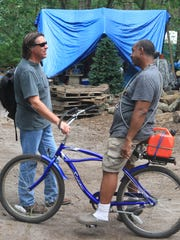 Jack Ballo (left), who made a documentary about life in Tent City, talks with William Brown, who was featured in the film in 2013.