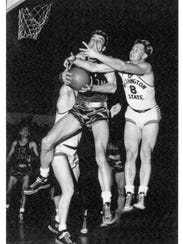 Jud Heathcote, right, during his playing days at Washington