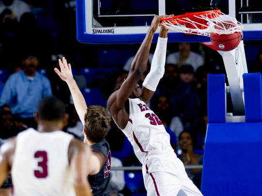 Memphis East's James Wiseman (32) dunks during a Division I Class AAA semifinals game between Bearden and Memphis East at the TSSAA boys state basketball championships at the Murphy Center in Murfreesboro, Tennessee on Friday, March 16, 2018.