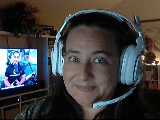 Valerie Lennert at home in her gaming room, with Souza