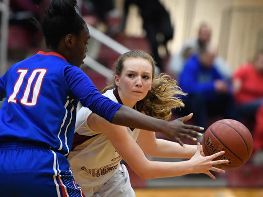 Webster's Marissa Austin looks to pass to a teammate as she drives around Christian's Tovah Wadlington as Webster County plays Christian County in the first Second Region semifinal game in Mortons Gap Friday, March 3, 2017.