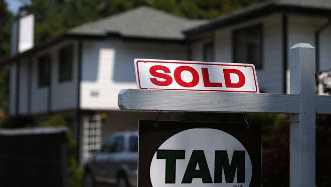 A sold sign is posted in front of a home for sale in San Anselmo, Calif.